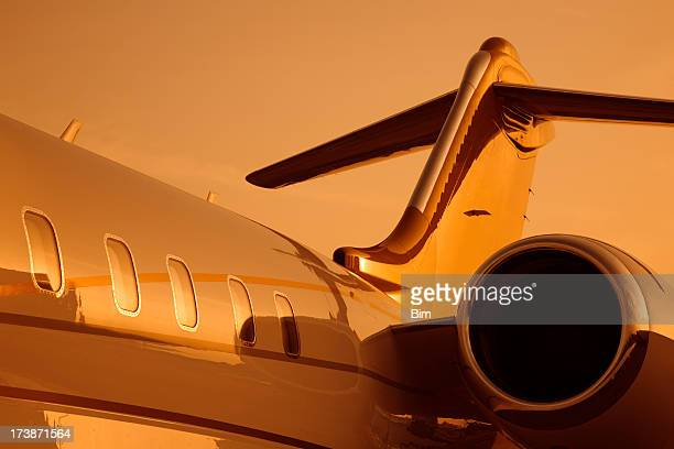 Corporate jet under orange sunset light