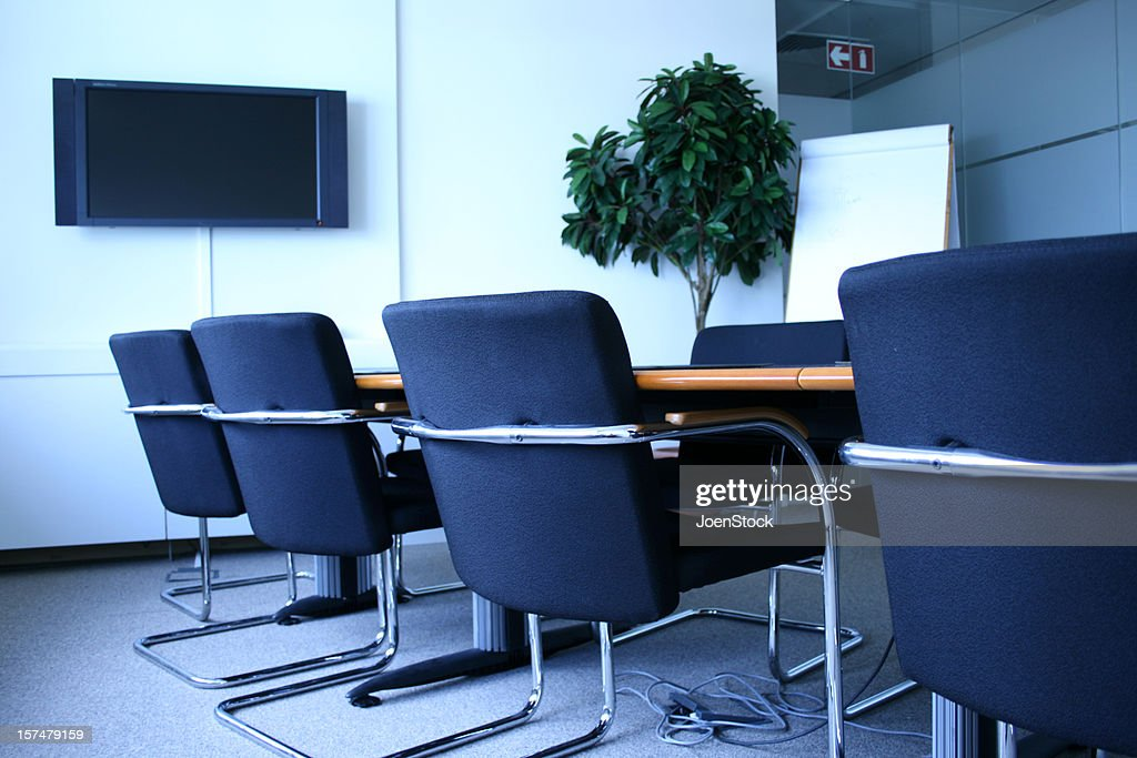 corporate office meeting room chairs and tv screen stock photo