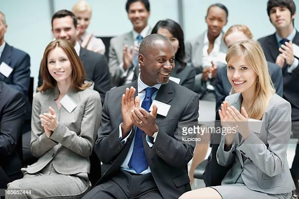 Corporate people applauding during seminar