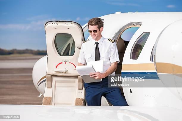 Corporate Pilot Reviewing Flight Book