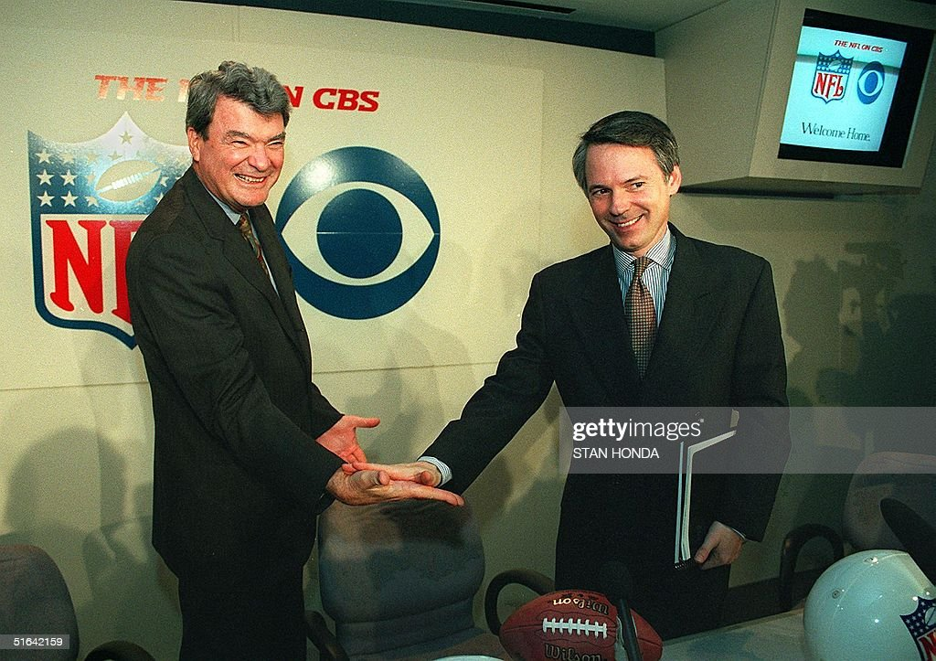 Corporation chairman and chief executive officer Michael H Jordan and Sean McManus president of CBS Sports congratulate each other at a news...