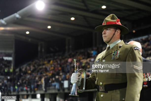 Corpral Rick Henderson of the NZ Army waits to play the last post before the round nine Super Rugby match between the Hurricanes and the Brumbies at...