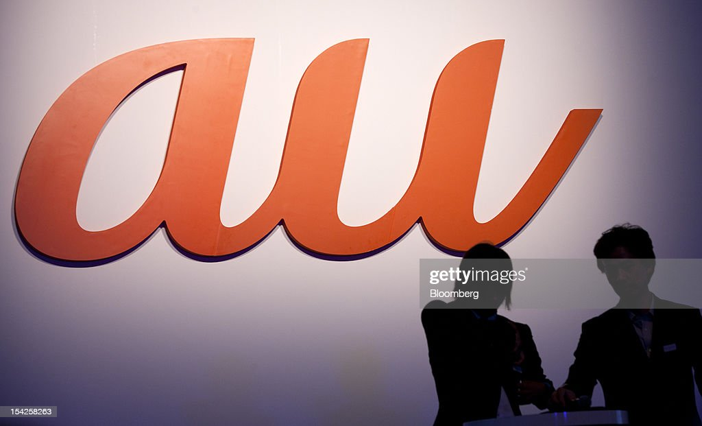Corp.'s 'au' brand logo is displayed at the unveiling of the company's new smartphone line-up in Tokyo, Japan, on Wednesday, Oct. 17, 2012. KDDI is Japan's second-largest mobile-phone carrier. Photographer: Tomohiro Ohsumi/Bloomberg via Getty Images