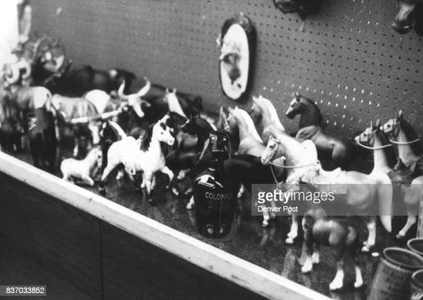 AUG 5 1972 AUG 16 1972 AUG 20 1972 'Corral' Of Colorado Souvenirs is at Woolworth's Jug with protuding dog's head says 'Colorado Booze Hound' Credit...