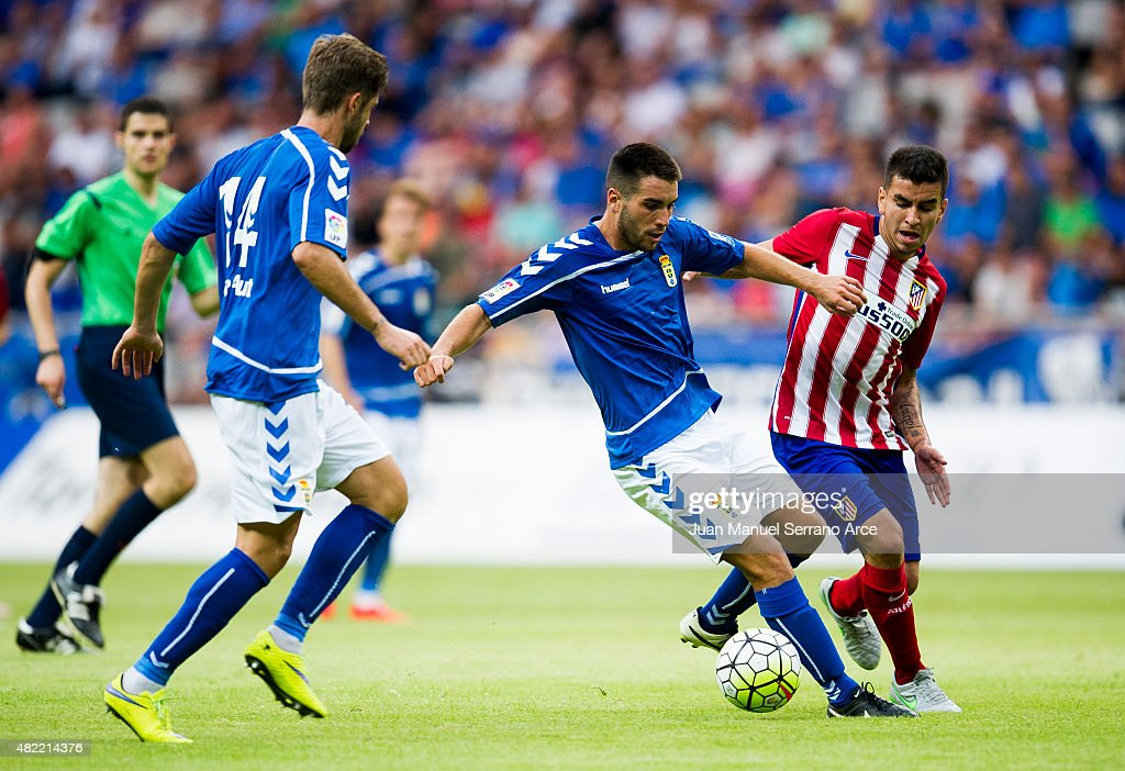Correa of Club Atletico de Madrid duels for the ball with Borja Gomez of Real Oviedo during a pre season friendly match between Real Oviedo and Club...
