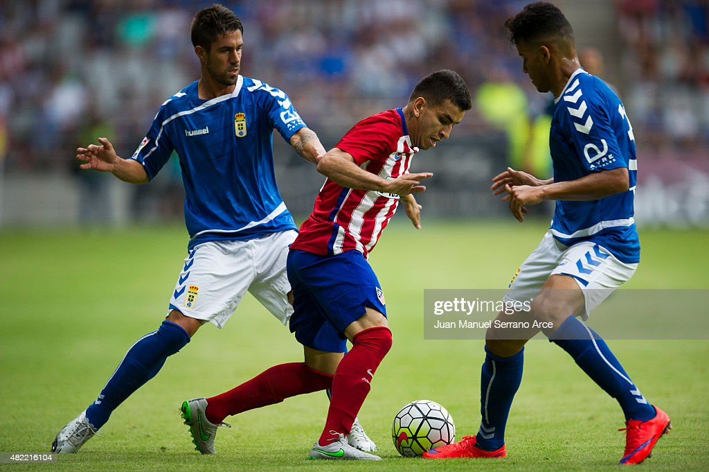 Correa ofÊClub Atletico de Madrid duels for the ball with Allyson of Real Oviedo during a pre season friendly match between Real Oviedo and Club...