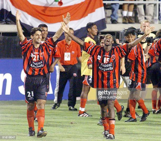 Correa Valente and McDonald Wallace of the Costa Rican team Alajuela celebrate after their team won in overtime penalty kicks 54 beating the Chicago...