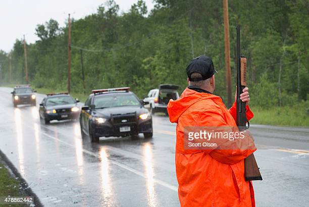 Correction officers man a roadblock along Highway 30 near a wooded area where they believe escaped convict David Sweat may be hiding on June 28 2015...