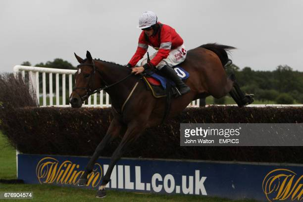 Corredor Sun ridden by Sam TwistonDavies jumps the fence during the Betfair iPhone Android App Handicap Chase