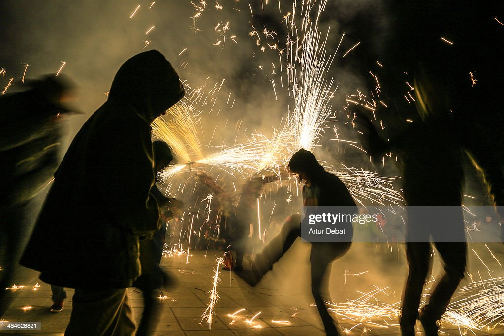 Correfocs in Catalonia at night with people.