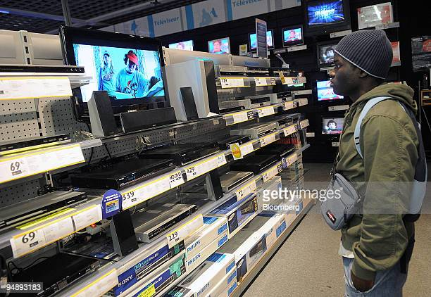 Correia Malam looks at DVD players in a Conforama store in Paris France on Tuesday Feb 26 2008 PPR SA the Parisbased owner of Gucci Group may report...