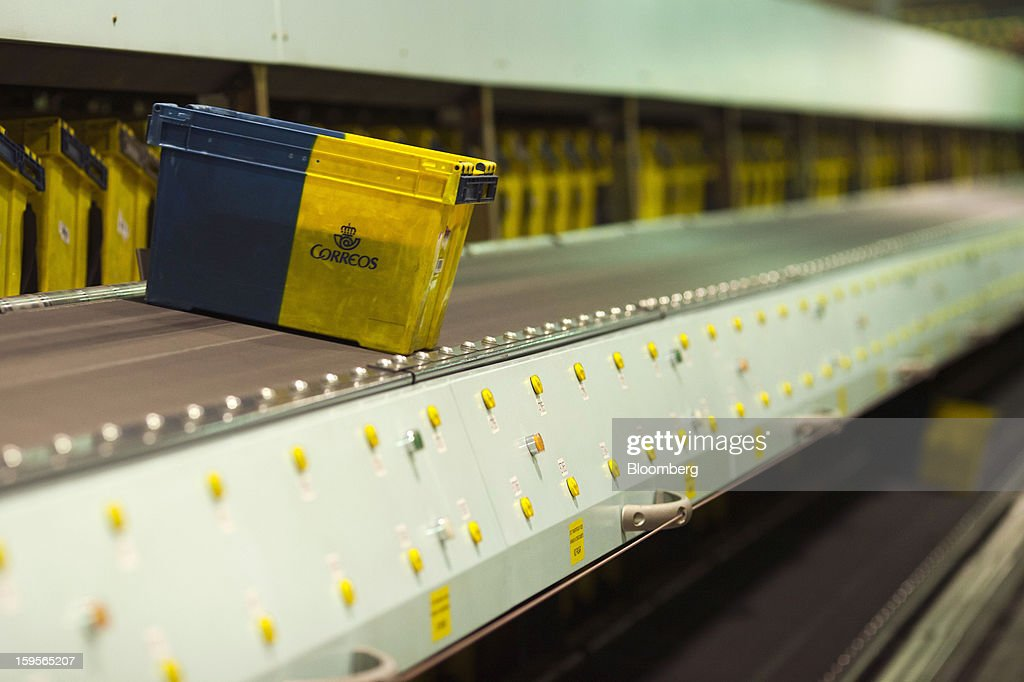 A Correos-branded crate passes along a conveyor belt at the central sorting office of Sociedad Estatal Correos y Telegrafos SA, also known as Correos, in Madrid, Spain, on Tuesday, Jan. 15, 2013. Spain plans to privatize its state-owned postal company, Sociedad Estatal Correos y Telegrafos SA, Expansion reported citing Federico Ferrer, Vice Chairman of the state holding company. Photographer: Angel Navarrete/Bloomberg via Getty Images