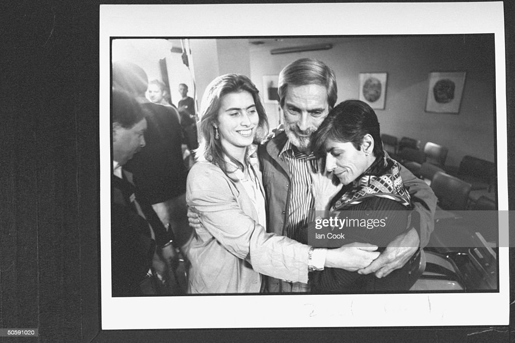 CBS correspondent Bob Simon joyfully embracing his wife Francoise daughter Tanya at press conference in Wellington Hospital after he was freed from...