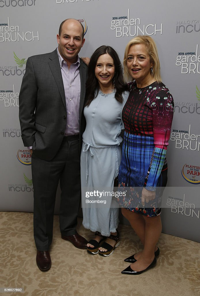 Correspondent Brian Stelter, from left, Jamie Stelter, and Democratic strategist Hilary Rosen attend the 23rd Annual White House Correspondents' Garden Brunch in Washington, D.C., U.S., on Saturday, April 30, 2016. The event will raise awareness for Halcyon Incubator, an organization that supports early stage social entrepreneurs 'seeking to change the world' through an immersive 18-month fellowship program. Photographer: Andrew Harrer/Bloomberg via Getty Images