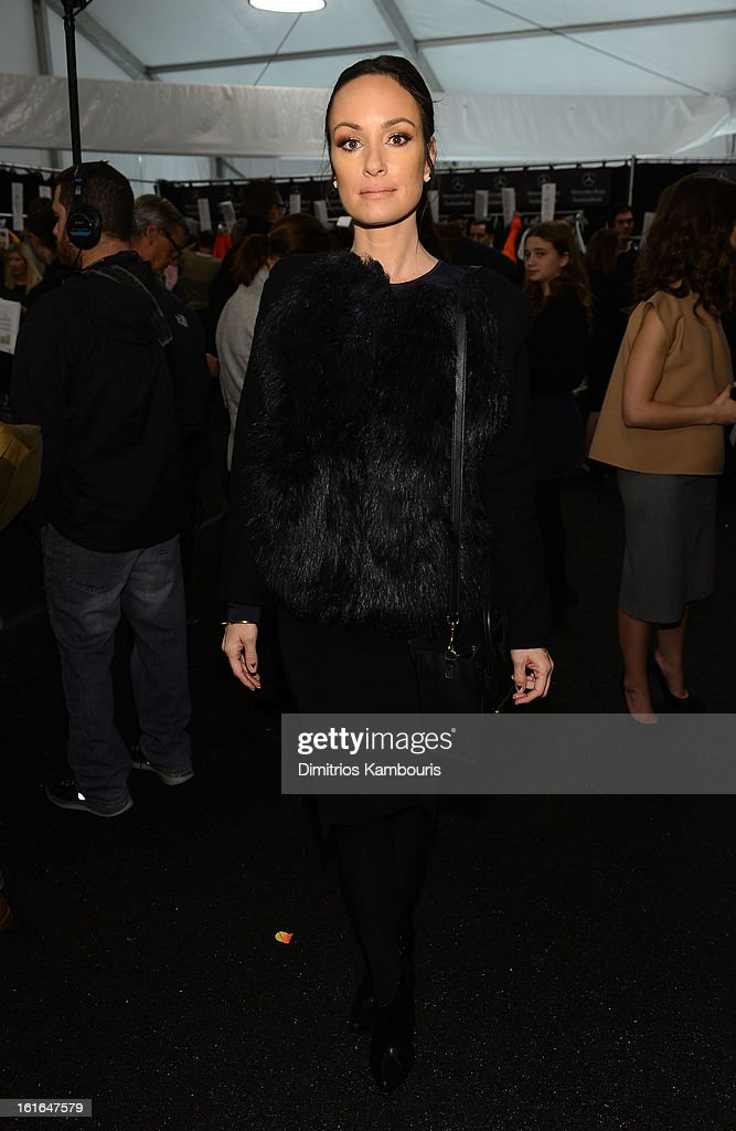 Correspondent Catt Sadler poses backstage at the Michael Kors Fall 2013 fashion show during Mercedes-Benz Fashion Week at The Theatre at Lincoln Center on February 13, 2013 in New York City.