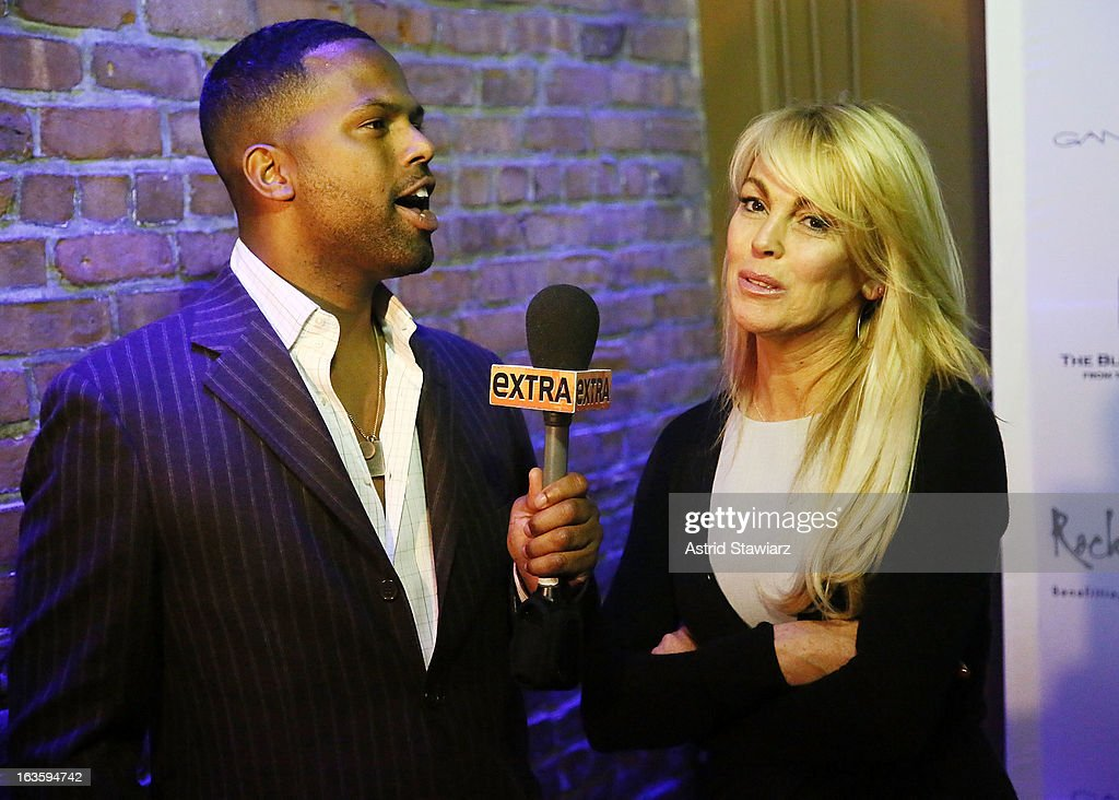 Correspondent for EXTRA, AJ Calloway talks with Dina Lohan at the ROCK ART LOVE at The Angel Orensanz Foundation on March 12, 2013 in New York City.