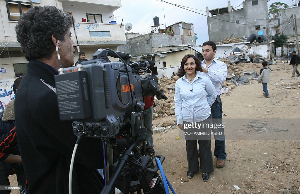Correspondent Nour Awdeh of the Al-Jazeera English-language news channel, the sister channel of Qatar's Arabic television Al-Jazeera, which hit the airwaves 15 November 2006, gets ready to do her report in the northern Gaza Strip town of Beit Hanun the scene of an Israeli military operation last week that left 19 people dead. Al-Jazeera English came on the airwaves today with a heavyweight cast of presenters and the ambition to compete with Western broadcasting giants. The English-language channel said its launch ushered in 'a new era in international news', and began broadcasts with a news bulletin featuring reports from the Gaza Strip, Sudan's Darfur region and Tehran. AFP PHOTO/MOHAMMED ABED