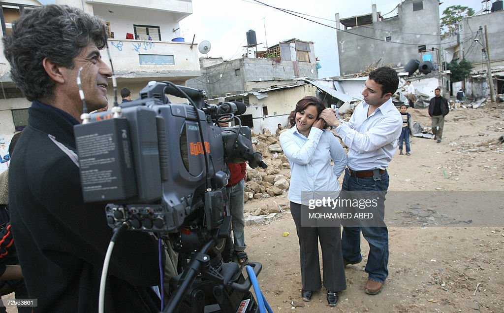 Correspondent Nour Awdeh of the Al-Jazeera English-language news channel, the sister channel of Qatar's Arabic television Al-Jazeera, which hit the airwaves 15 November 2006, gets ready to do her report in the northern Gaza Strip town of Beit Hanun the scene of an Israeli military operation last week that left 19 people dead. Al-Jazeera English came on the airwaves today with a heavyweight cast of presenters and the ambition to compete with Western broadcasting giants. The English-language channel said its launch ushered in 'a new era in international news', and began broadcasts with a news bulletin featuring reports from the Gaza Strip, Sudan's Darfur region and Tehran.