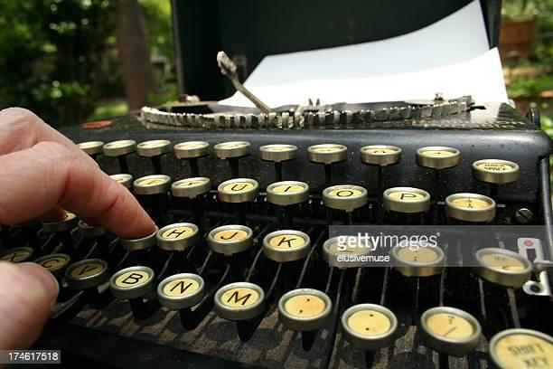Correspondent using Antique Typewriter