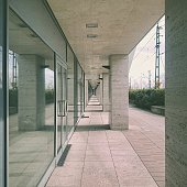 Corridor By Glass Entrance Of Building