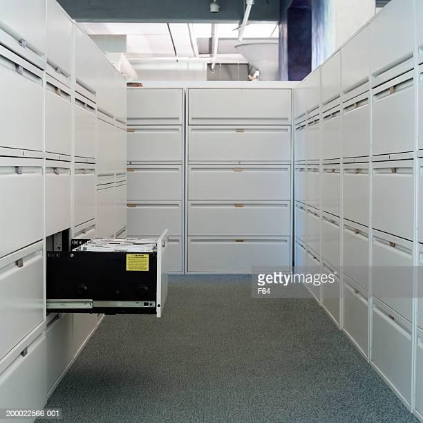 Corridor of file cabinets, office interior