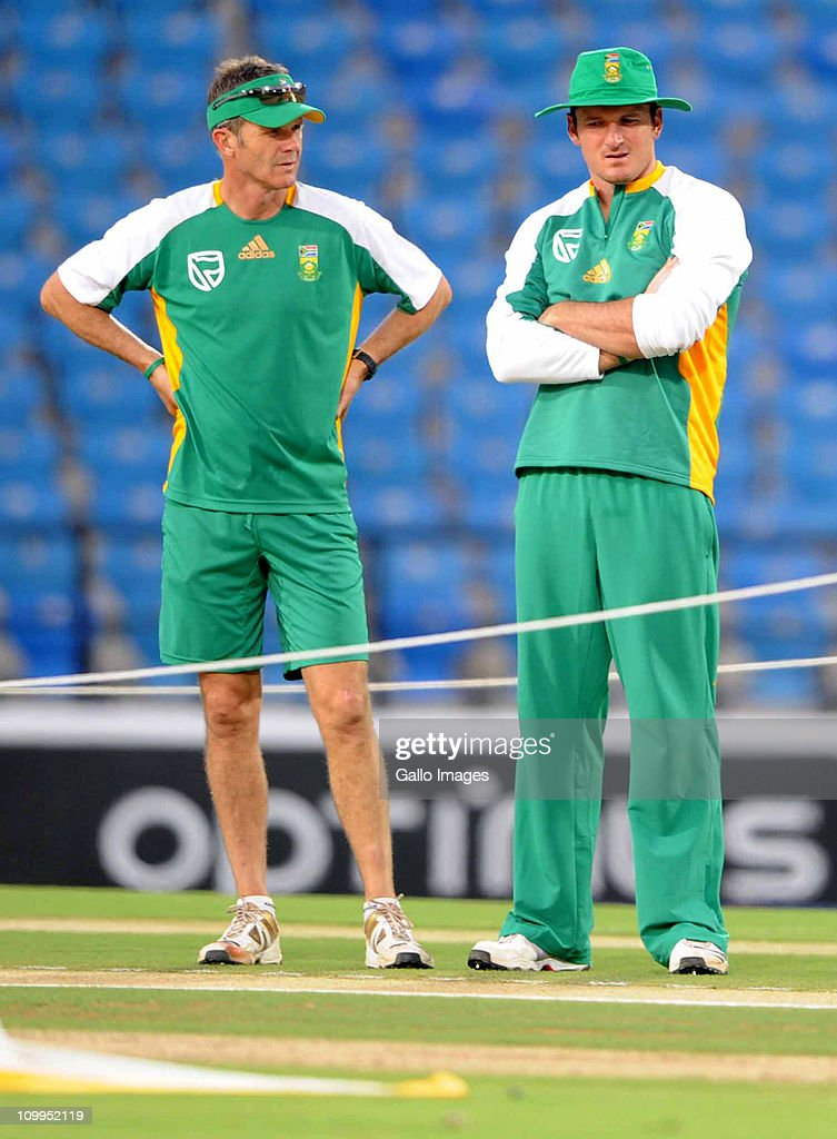 Corrie van Zyl (L) and <a gi-track='captionPersonalityLinkClicked' href=/galleries/search?phrase=Graeme+Smith&family=editorial&specificpeople=193816 ng-click='$event.stopPropagation()'>Graeme Smith</a> of South Africa talk during a Proteas nets session at VCA Stadium on March 11, 2011 in Nagpur, India.