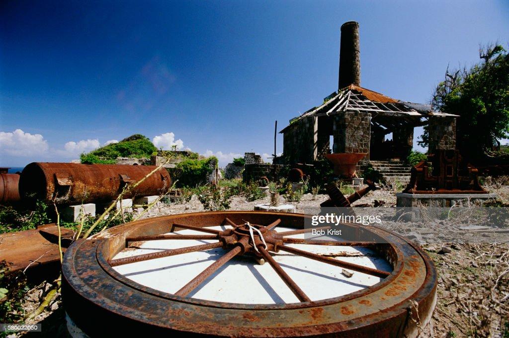 Corroding Wheel Outside Abandoned Sugar Mill