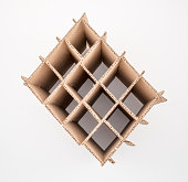 Overhead view of double-walled, corrugated box partition on white background