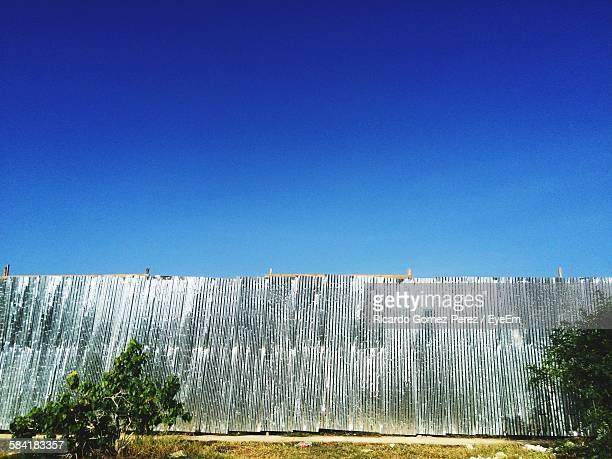 Corrugated Iron Wall Against Clear Blue Sky