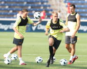 Corry Evans Darren Fletcher and Darron Gibson of Manchester United in action during a First Team Training Session as part of their preseason tour of...