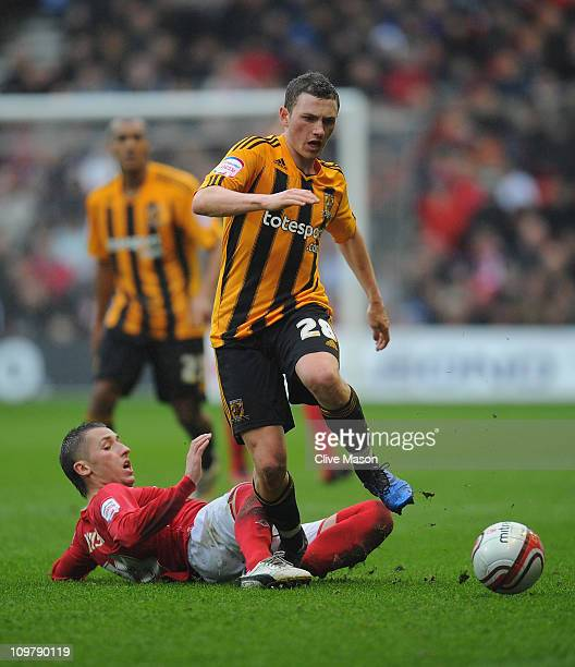 Corry Evans of Hull City is challenged by Radoslaw Majewski of Nottingham Forest during the npower Championship match between Nottingham Forest and...