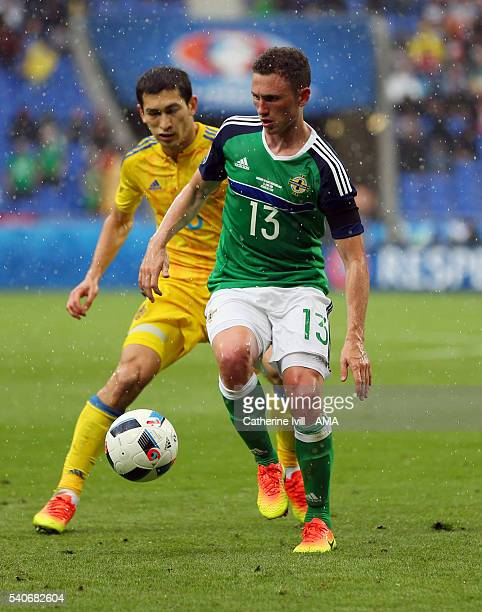 Corry Evans of Northern Ireland and Roman Zozulya of Ukraine during the UEFA EURO 2016 Group C match between Ukraine and Northern Ireland at Stade...