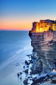 Twilight on the beautiful cliffs and buildings of Bonifacio, Corsica Island, France.