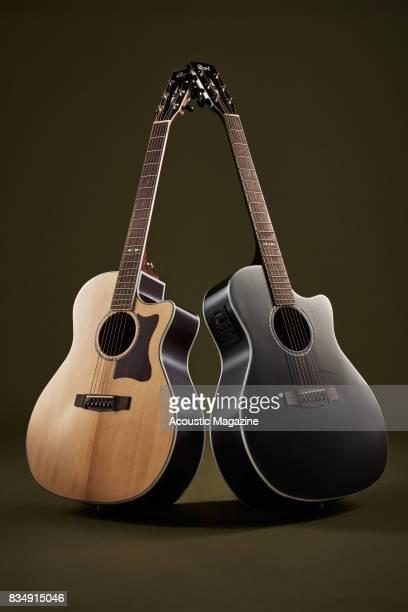 A Cort Grand Regal GA5FBK and Cort Grand Regal GA5FMD NAT electroacoustic guitar taken on November 16 2016