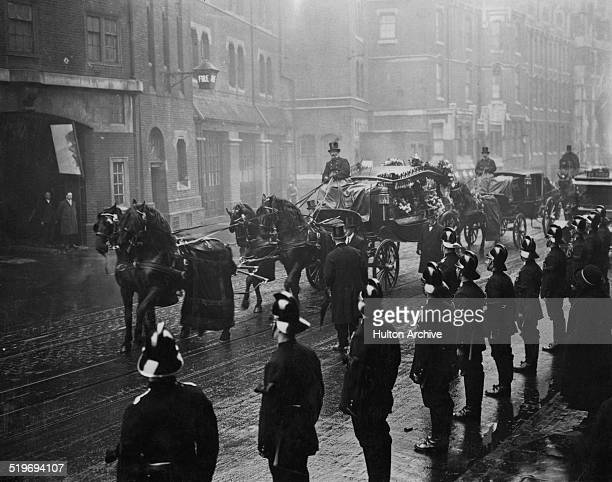 A cortege for a fireman passes the London County Council Fire Brigade on Southwark Bridge Road London 28th February 1923