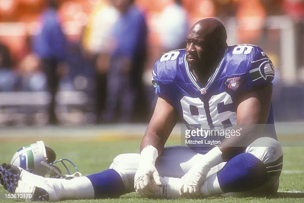 Cortez Kennedy of the Seattle Seahawks looks on before a football game against the Washington Redskins on November 19 1995 at RFK Stadium in...