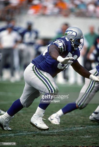 Cortez Kennedy of the Seattle Seahawks pursues the play against the Miami Dolphins during an NFL football game December 16 1990 at Joe Robbie Stadium...