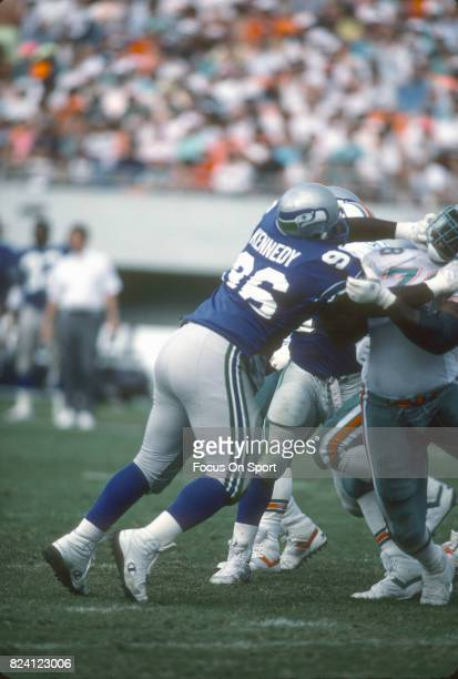Cortez Kennedy of the Seattle Seahawks rushes up against Richmond Webb of the Miami Dolphins during an NFL football game December 16 1990 at Joe...
