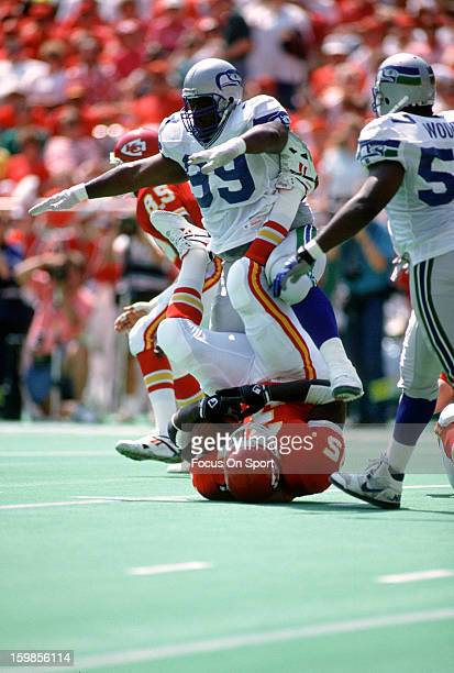 Cortez Kennedy of the Seattle Seahawks tackles Christian Okoye of the Kansas City Chiefs during an NFL football game September 13 1992 at Arrowhead...