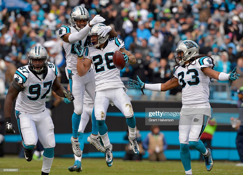 Cortland Finnegan Josh Norman Tre Boston and Mario Addison of the Carolina Panthers celebrate an interception against the Seattle Seahawks in the 1st...