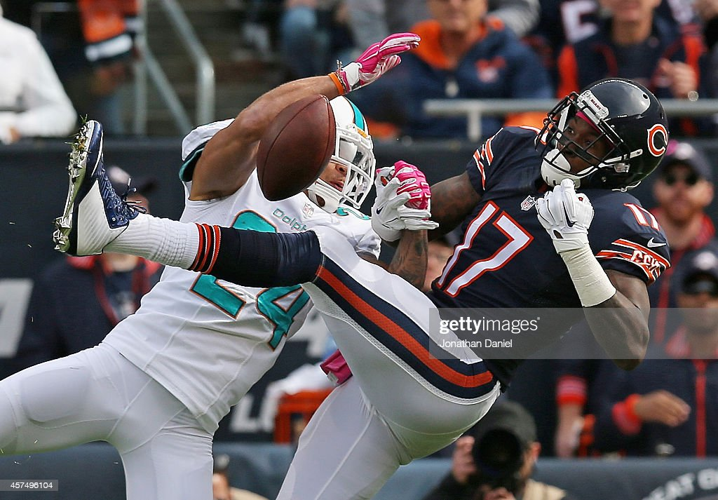 Cortland Finnegan #24 of the Miami Dolphins breaks up a pass intended for Alshon Jeffery #17 of the Chicago Bears at Soldier Field on October 19, 2014 in Chicago, Illinois.