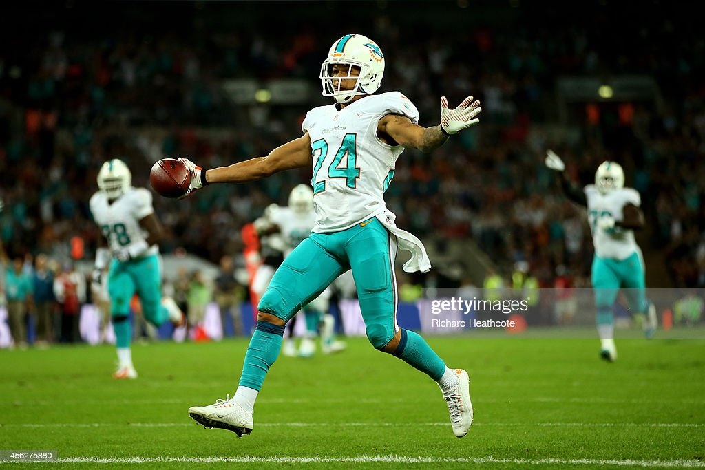 Cortland Finnegan #24 of the Miami Dolphins returns a fumble 50 yards to score a touchdown during the NFL match between the Oakland Raiders and the Miami Dolphins at Wembley Stadium on September 28, 2014 in London, England.