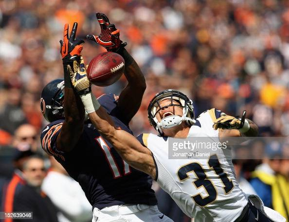 Cortland Finnegan of the St Louis Rams breaks up a pass intended for Alshon Jeffery of the Chicago Bears at Soldier Field on September 23 2012 in...