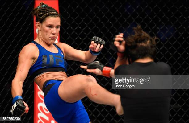 Cortney Casey kicks Jessica Aguilar in their women's strawweight fight during the UFC 211 event at the American Airlines Center on May 13 2017 in...