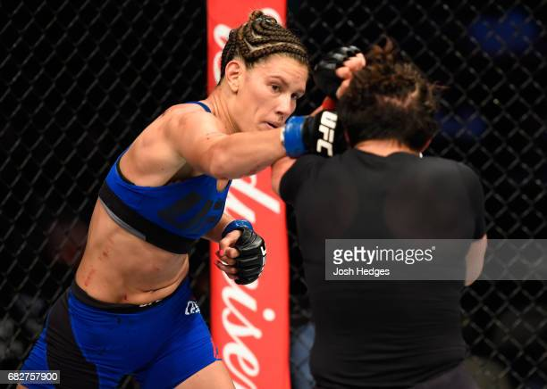 Cortney Casey punches Jessica Aguilar in their women's strawweight fight during the UFC 211 event at the American Airlines Center on May 13 2017 in...