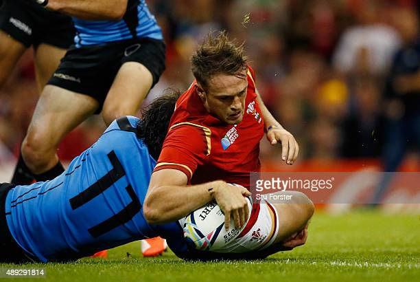 Cory Allen of Wales goes over to score his teams second try during the 2015 Rugby World Cup Pool A match between Wales and Uruguay at the Millennium...