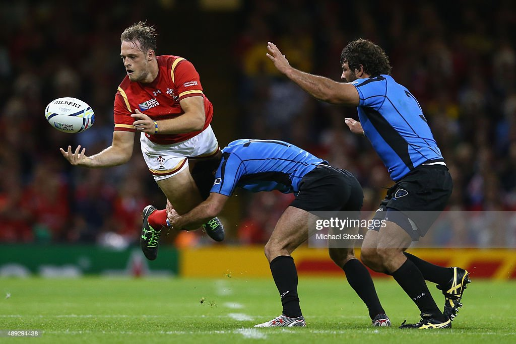 <a gi-track='captionPersonalityLinkClicked' href=/galleries/search?phrase=Cory+Allen+-+Rugby+Player&family=editorial&specificpeople=8534487 ng-click='$event.stopPropagation()'>Cory Allen</a> of Wales offloads the ball as he iis tackled by Rodrigo Silva of Uruguay during the 2015 Rugby World Cup Pool A match between Wales and Uruguay at Millennium Stadium on September 20, 2015 in Cardiff, United Kingdom.