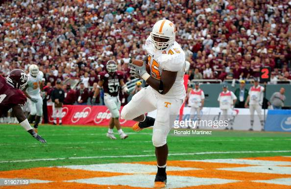 Cory Anderson of the Tennessee Volunteers makes a touchdown pass reception against the Texas AM Aggies during the SBC Cotton Bowl in the first...