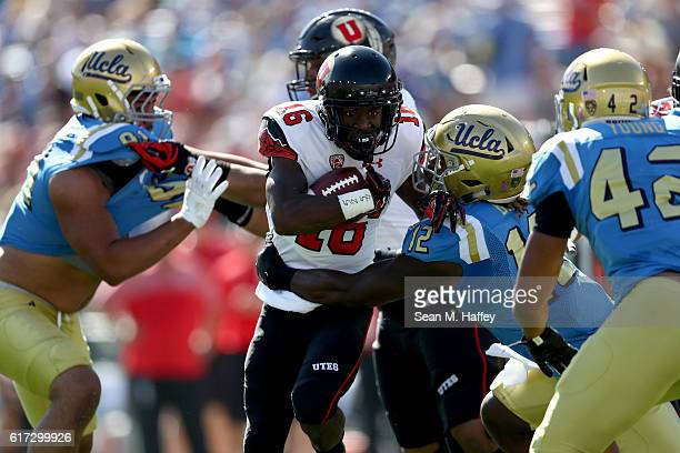 Cory ButlerByrd of the Utah Utes breaks a tackle by Jayon Brown of the UCLA Bruins during the first half of a game at the Rose Bowl on October 22...