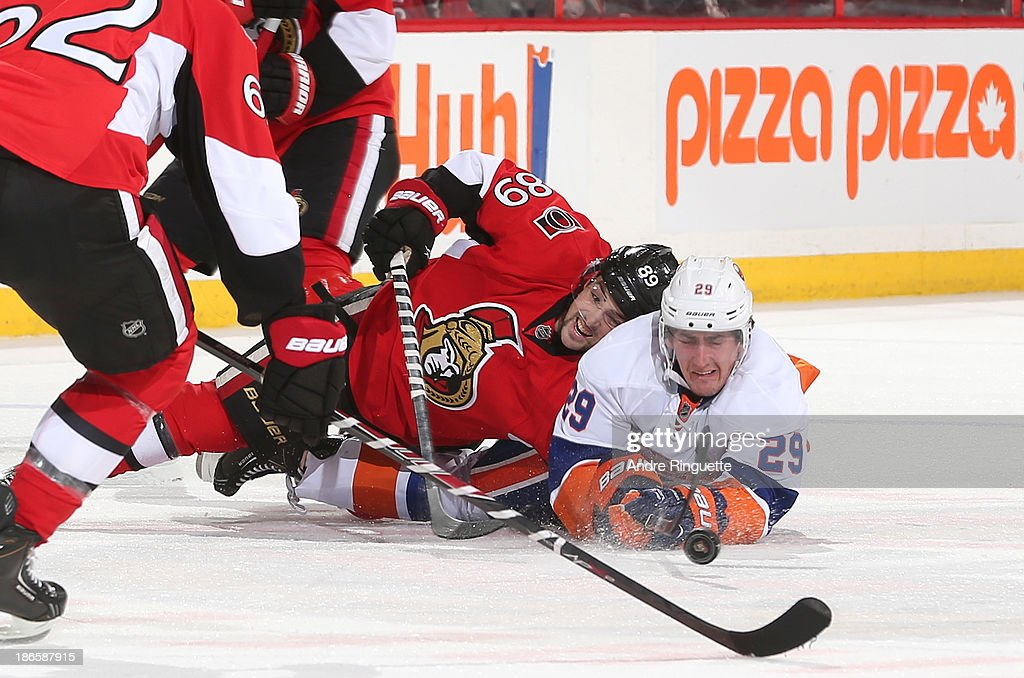 <a gi-track='captionPersonalityLinkClicked' href=/galleries/search?phrase=Cory+Conacher&family=editorial&specificpeople=8312407 ng-click='$event.stopPropagation()'>Cory Conacher</a> #89 of the Ottawa Senators and <a gi-track='captionPersonalityLinkClicked' href=/galleries/search?phrase=Brock+Nelson&family=editorial&specificpeople=7029374 ng-click='$event.stopPropagation()'>Brock Nelson</a> #29 of the New York Islanders fall to the ice battling for a loose puck at Canadian Tire Centre on November 1, 2013 in Ottawa, Ontario, Canada.